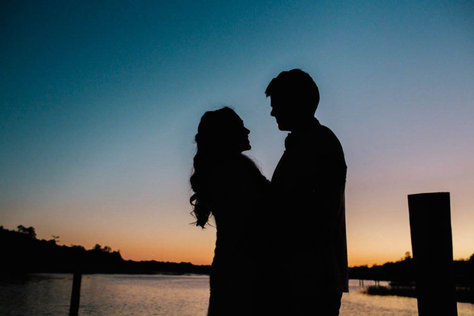 Bride and groom stand on dock at sunset, Boone Hall Plantation, Charleston, South Carolina. Kate Timbers Photography. http://katetimbers.com #katetimbersphotography // Charleston Wedding Photography // Posing Silhouette Inspiration