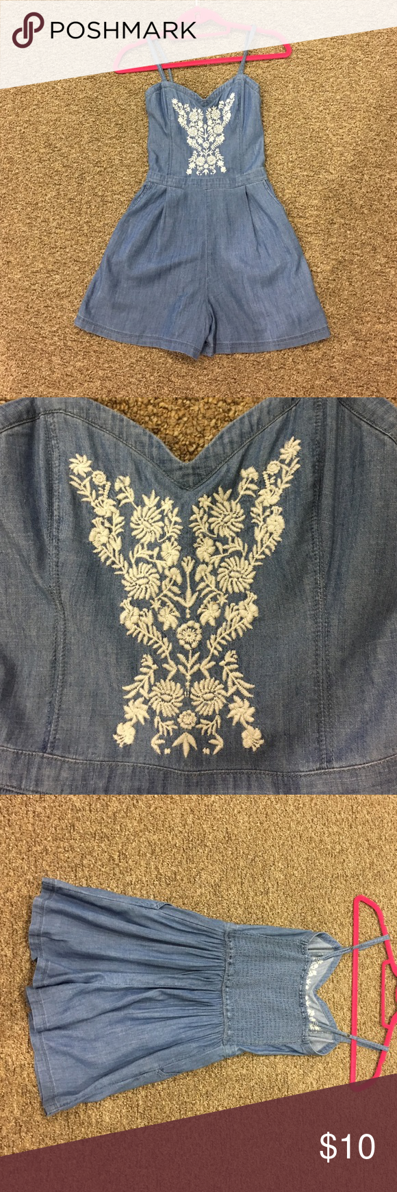 Hollister blue jean romper Perfect condition Hollister blue jean romper with adorable floral design! Hollister Pants Jumpsuits & Rompers