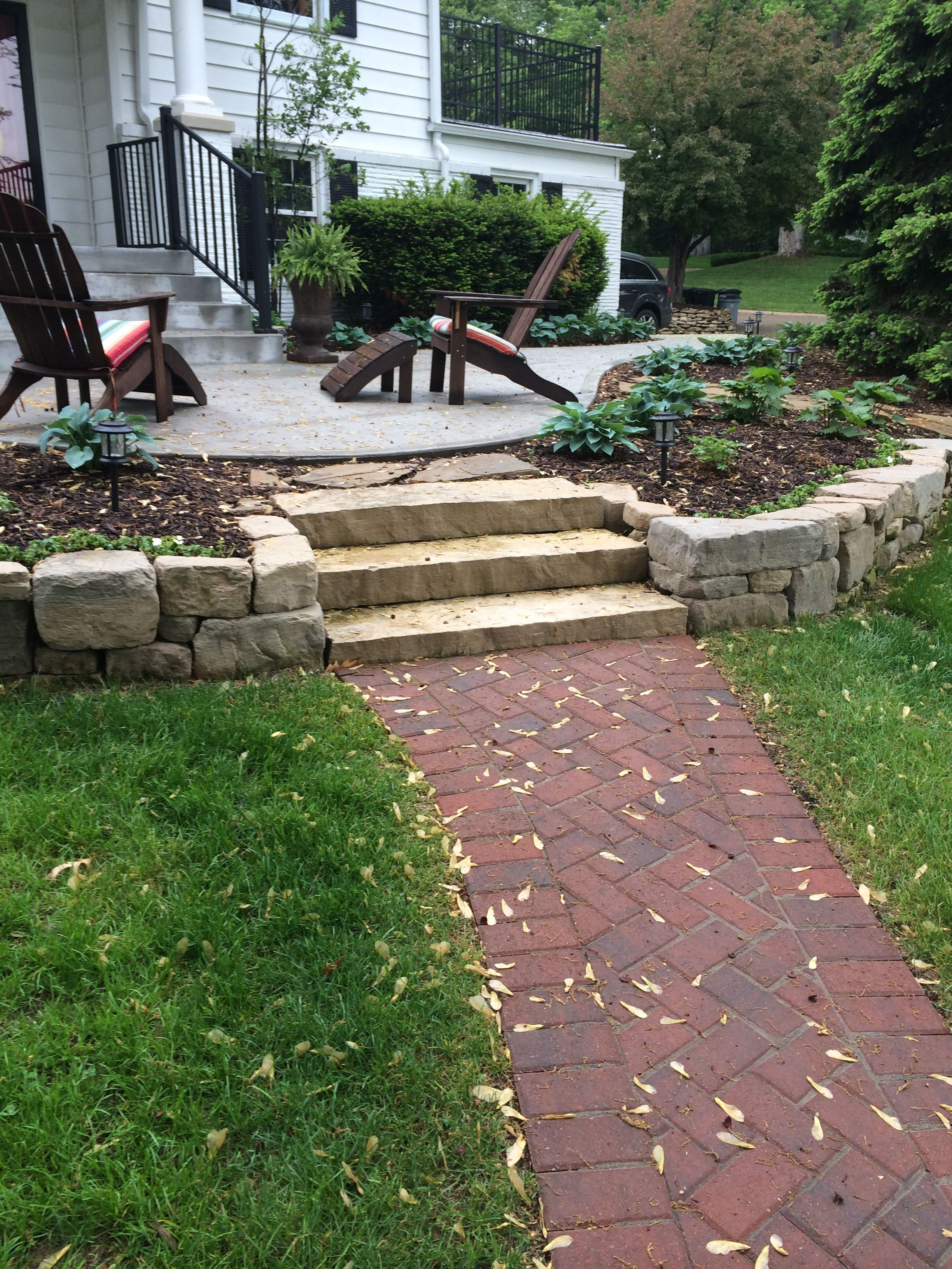 Natural Stone Steps With Limestone Retaining Wall At Front Door