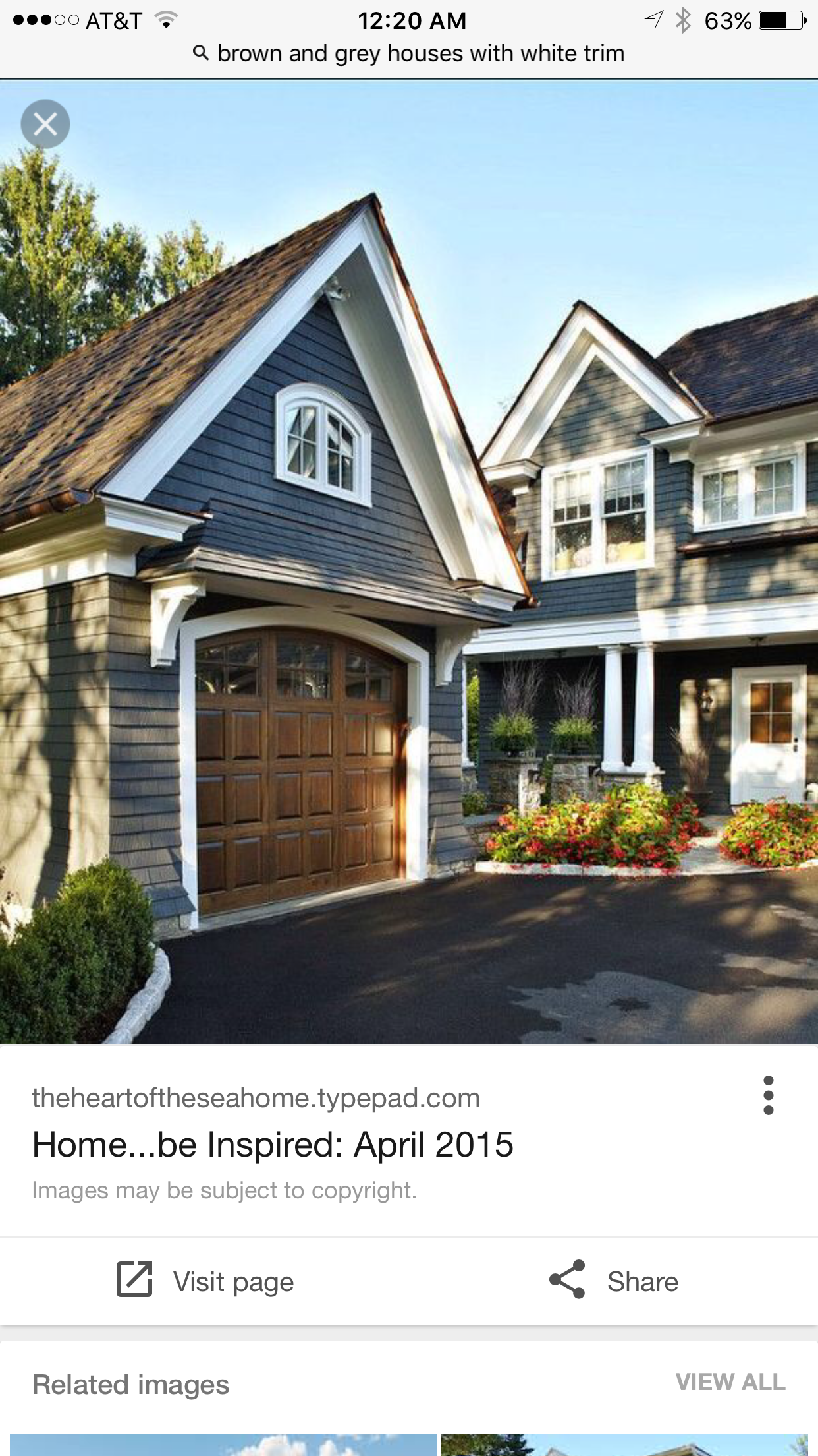 Dark Blue Siding With Brown Roof And Doors
