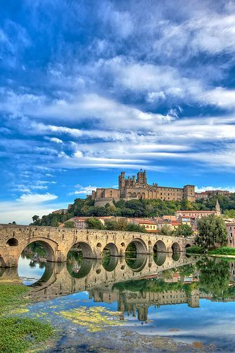 View from the river of the 13th century Roman Catholic cathedral in Beziers, France.