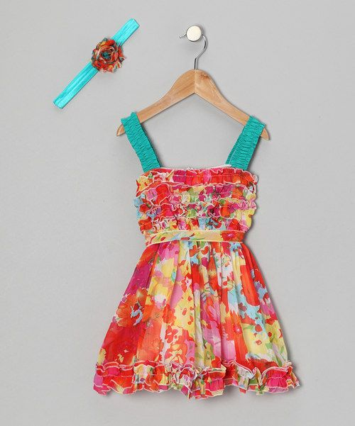 This set stands out in the best way—stylishly! With bright colors to enhance the prints and floral pops, it's sure to make a statement at any event. Includes dress and headband100% polyesterMachine wash; tumble dryMade in the USA