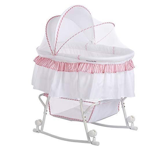Spacious Bassinet Mattress pad Transforms into a rocking cradle by rotating wheels in upward position Sizable basket for babies' essentials Hooded locking wheels For use from birth until approximately 20 lbs. or until baby can push-up/roll over unassisted Adult assembly required Meets the CPSC and ASTM standard and ASTM F2194 Full canopy use as a mosquito net