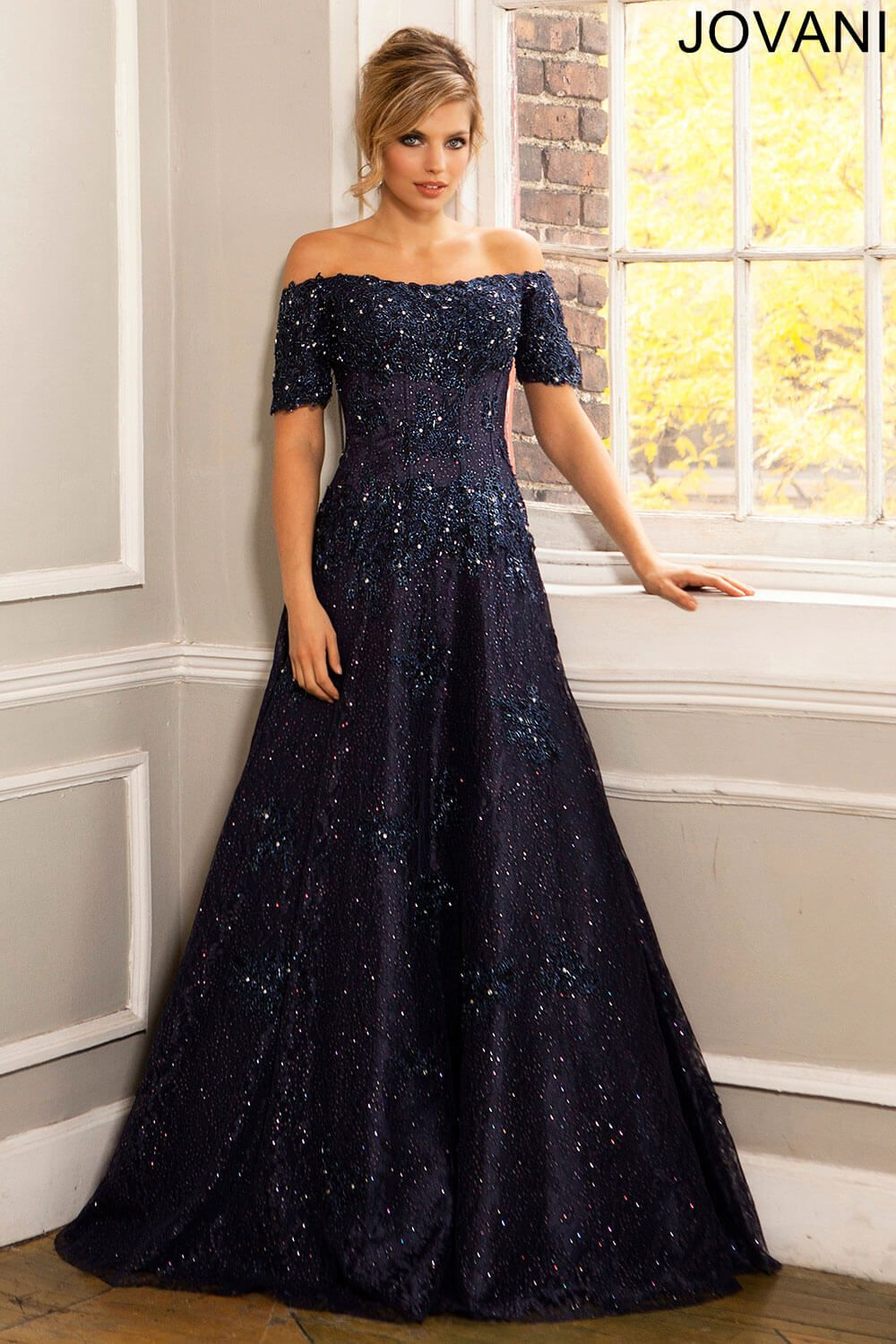 Gorgeous navy off the shoulder a-line gown features exposed piping ...