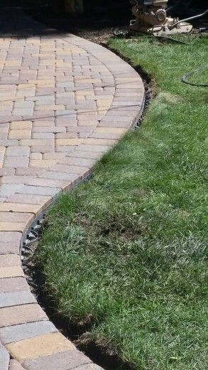 Pavers With Plastic Edging And Spikes As Edge Restraint