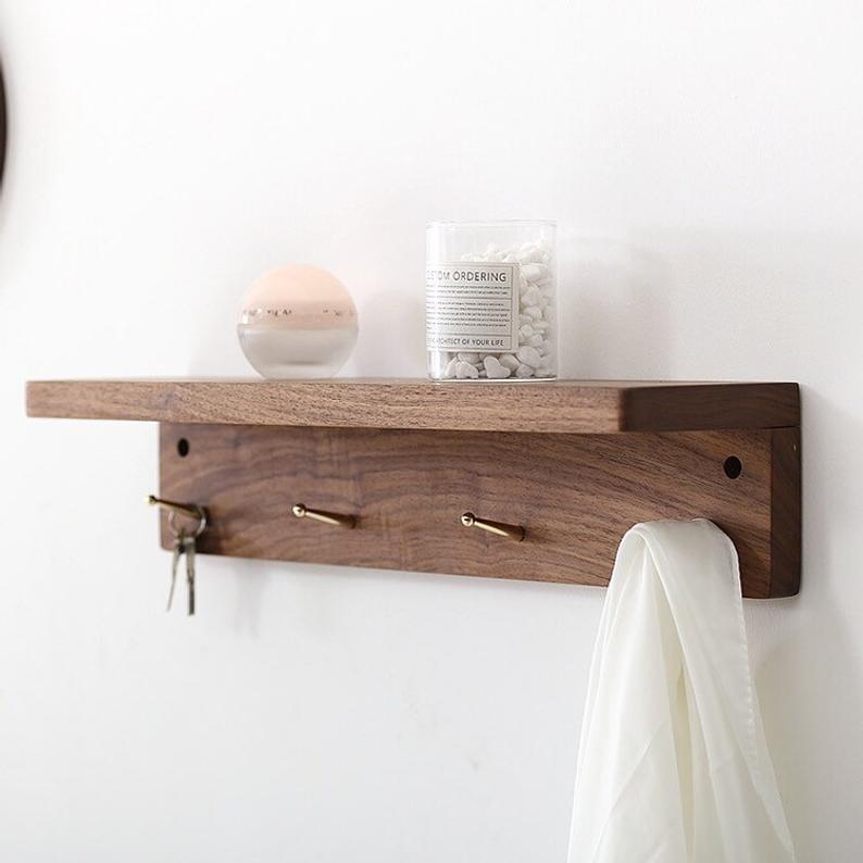 Walnut Wooden Wall Shelf With Hangers Coat Racks With Brass Etsy Wooden Wall Shelves Wall Shelves Shelves Wood wall shelf with hooks