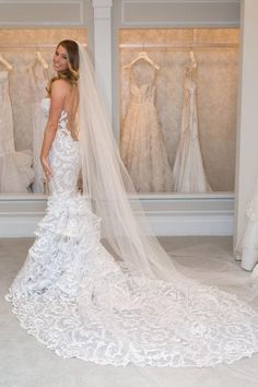 Lots Of Lace And A Super Low Cut Open Back Makes This Pnina Tornai Wedding Dress Extra Breathtaking The Long Veil Doesnt Hurt Either