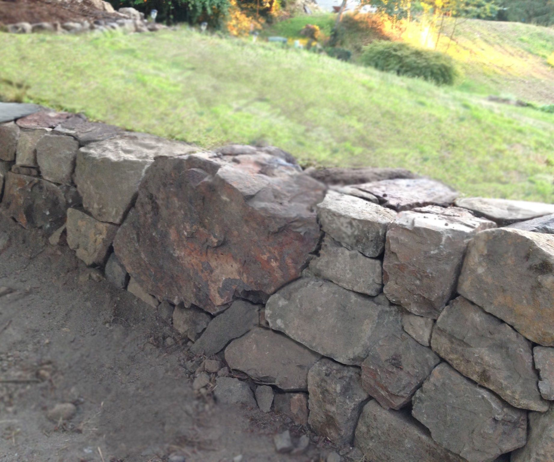How To Build A Natural Dry Stacked Stone Free Standing Or Retaining Rock Wall Rock Wall Gardens Stone Walls Garden Rock Wall Landscape