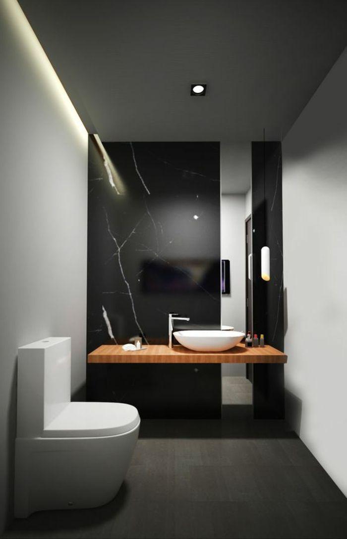 salle de bain carrelage gris foncé, mur en marbre noir, spot