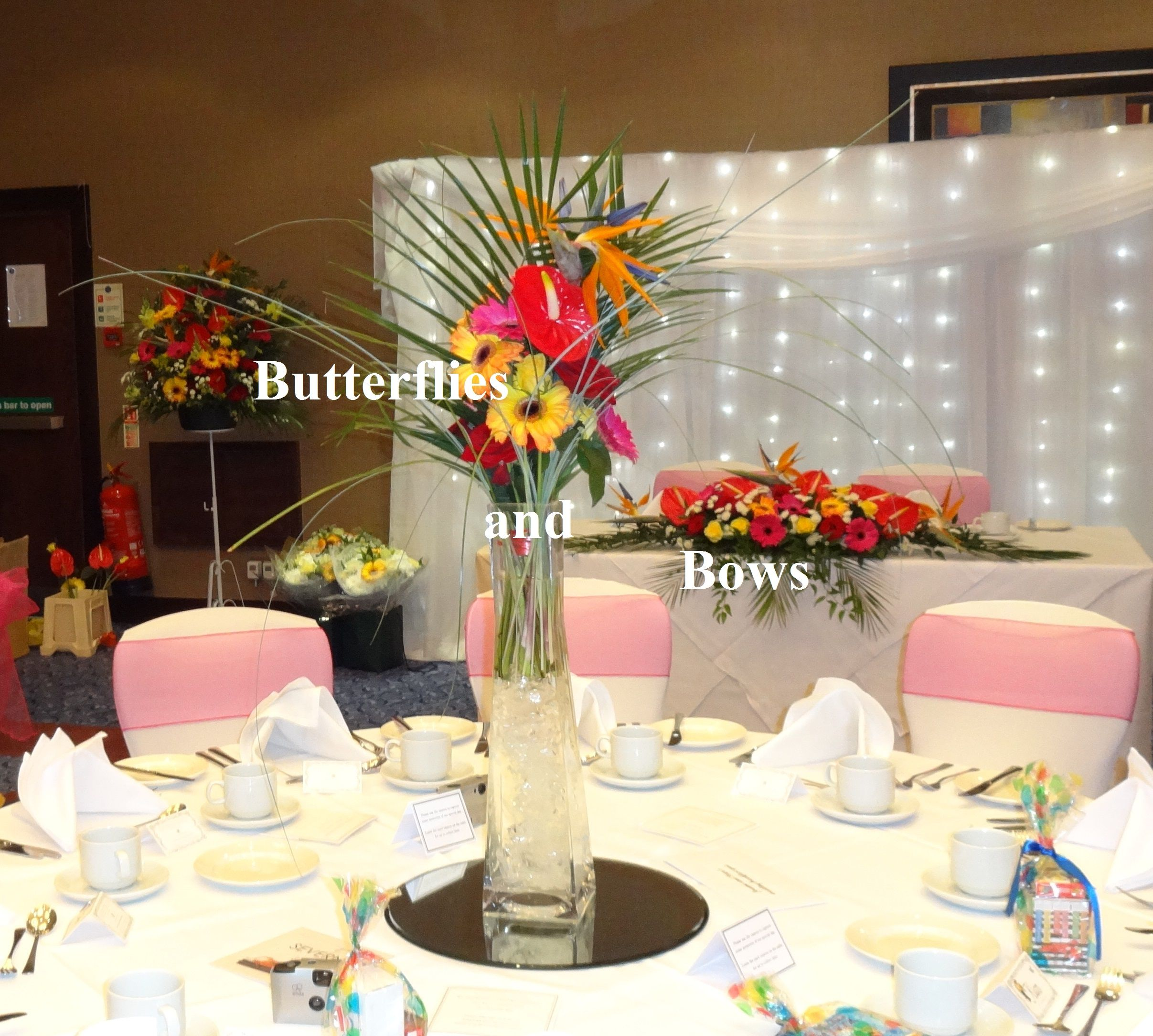 tropical table centres, pedestals and top table flowers