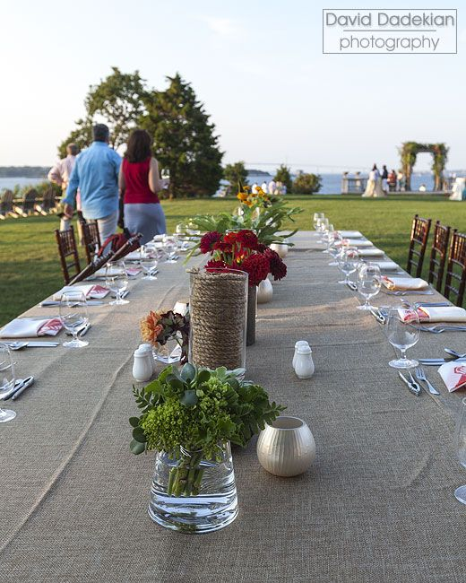 Guests sample hors d\'oeuvres on the lawn while watching the clambake ...