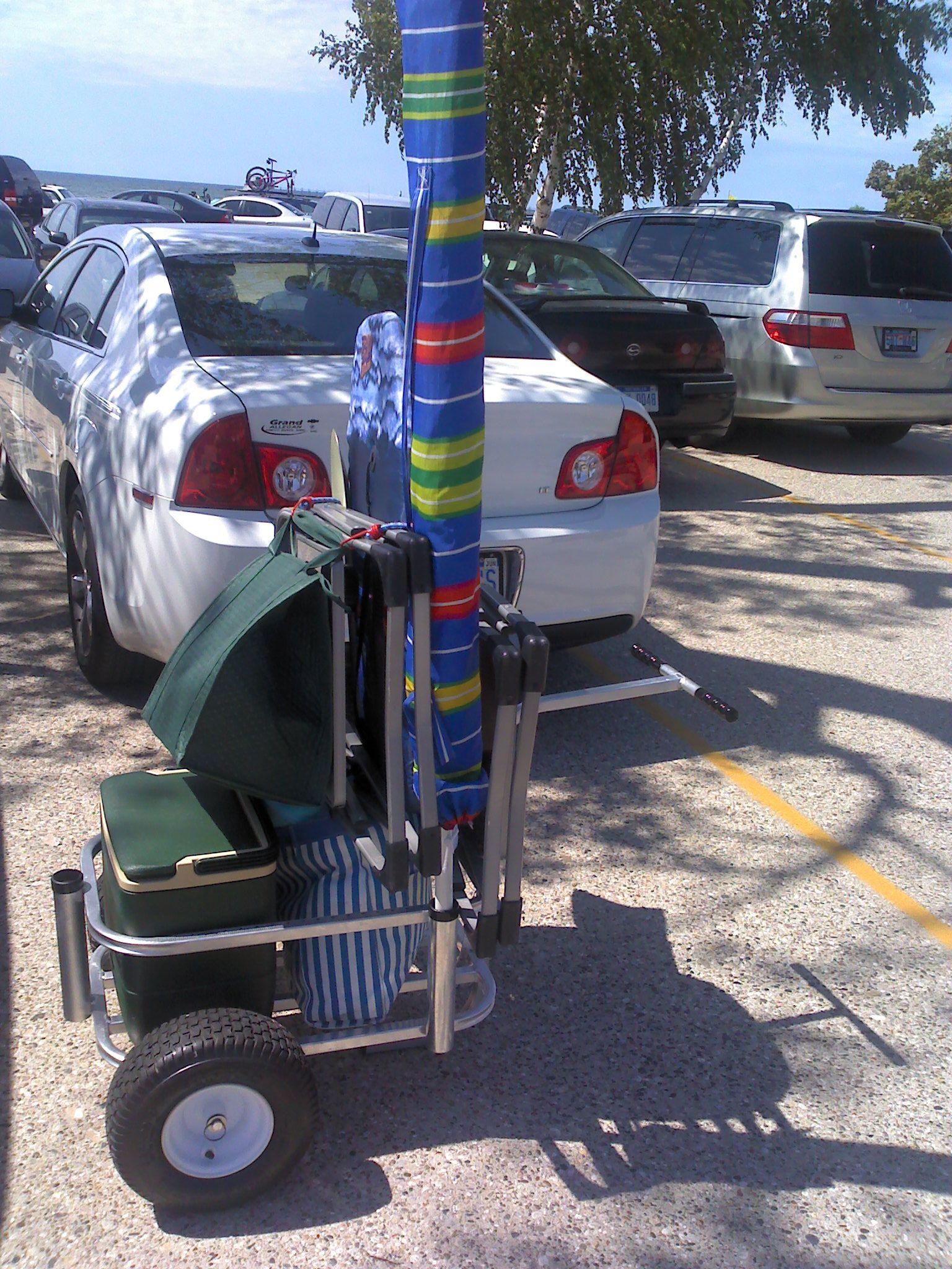 df52f5ec5d5e beach cart fully loaded. Cooler,snack bag, beach bag,umbrella,chairs ...