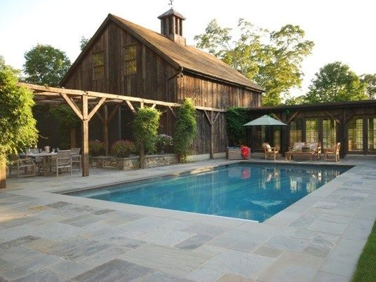 Stone pool deck country landscape design hoffman for Pool deck landscaping