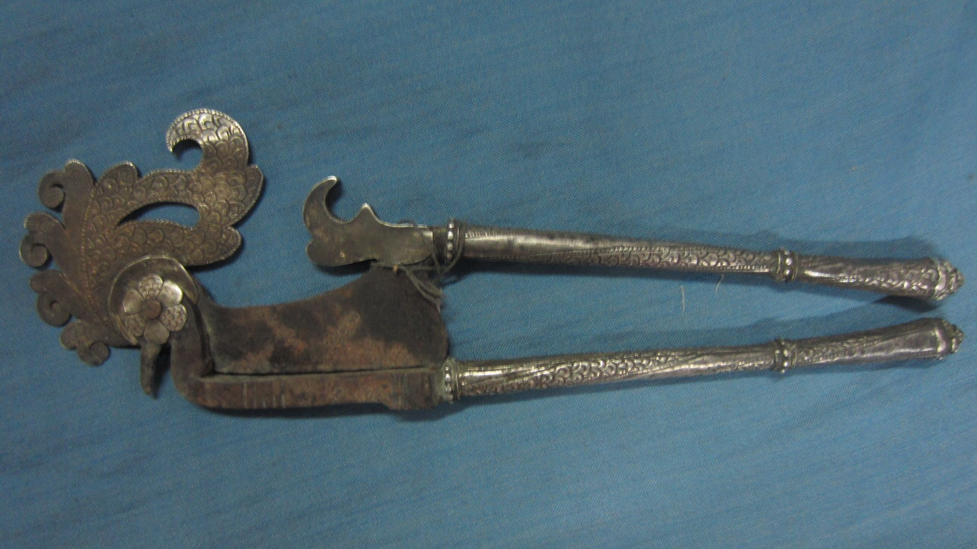 Old iron and silver clad betel nut cutter, kacip, used to cut the