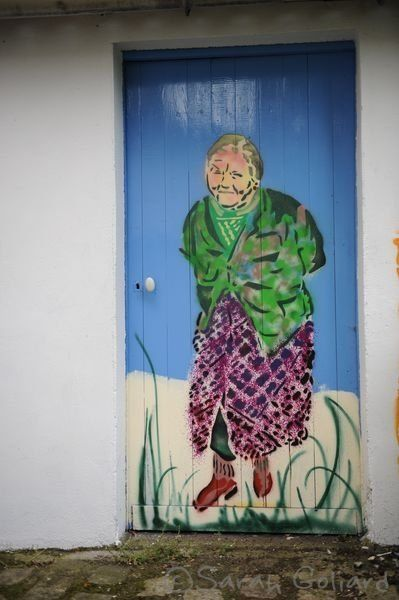 Lady on a door. Paris