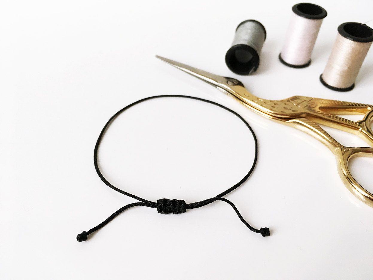 black bracelet with a closing sliding flat knot macrame. Black Bedroom Furniture Sets. Home Design Ideas
