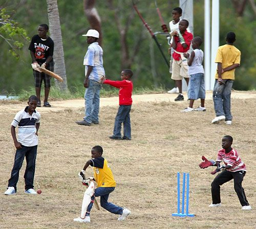 Kids play cricket adjacent to the stadium, Jamaica What else