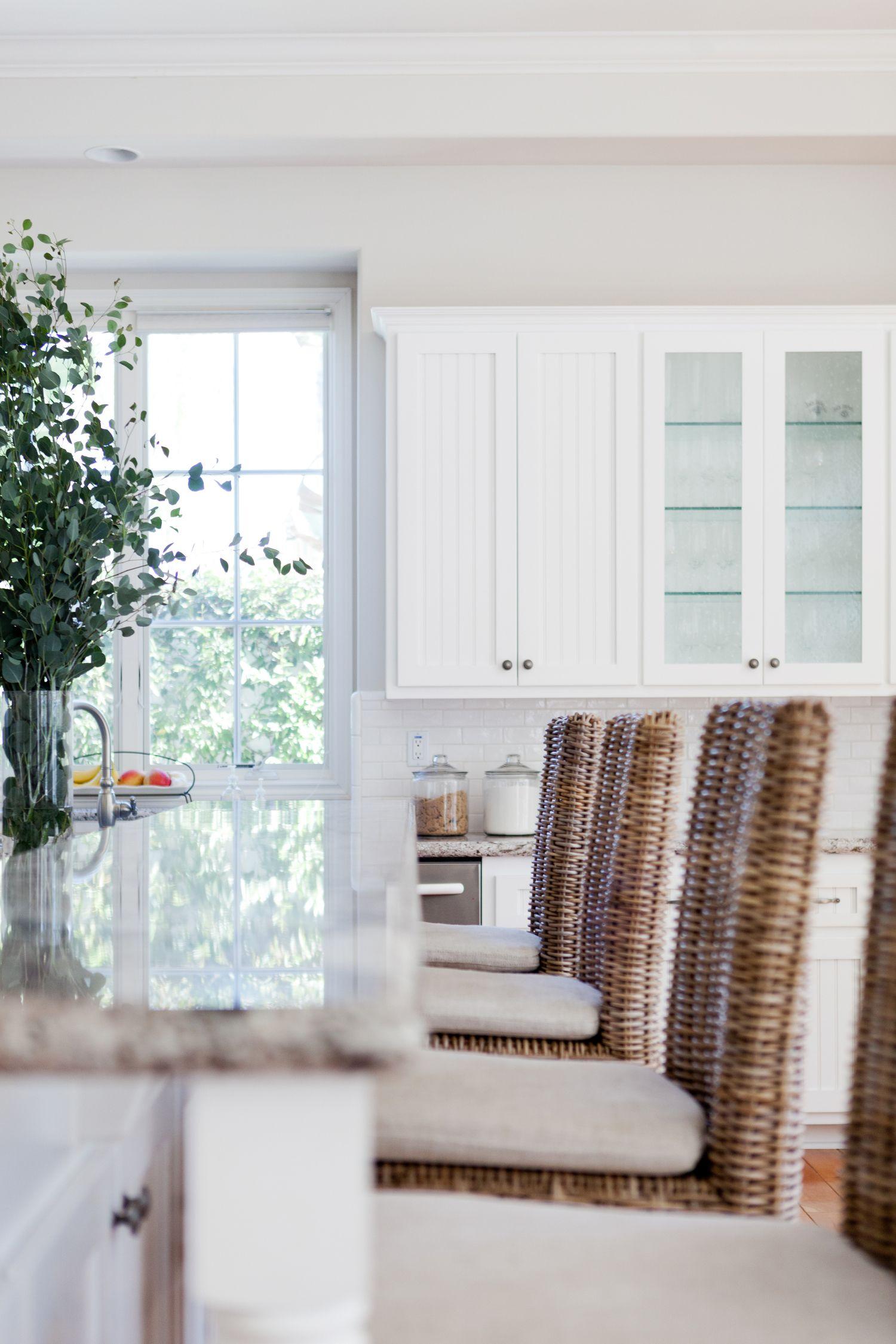 All White Kitchen Design With Wicker Bar Stools J Kurtz Design Modern Kitchen Interiors Kitchen Interior Design Modern New Kitchen Designs