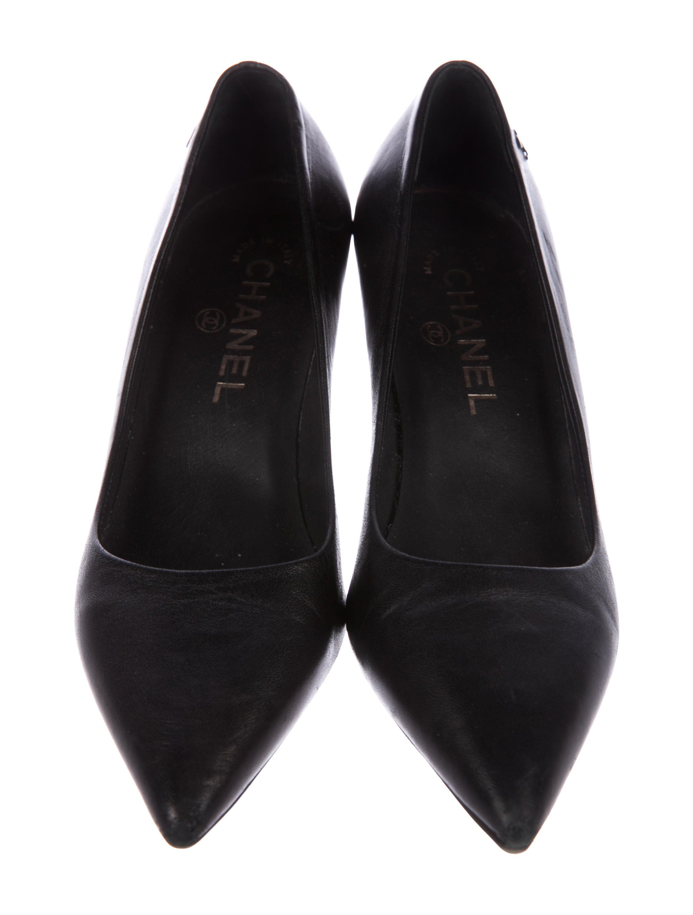 5a01215e9b2 Black leather Chanel pointed-toe pumps with silver-tone interlocking CC at  sides and covered heels.
