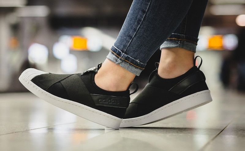 70fc2051a548 The adidas Superstar Slip On Comes In Core Black White.
