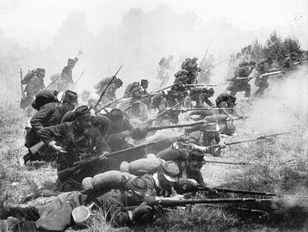 French troops charge out of their trench early in the war, probably 1914.