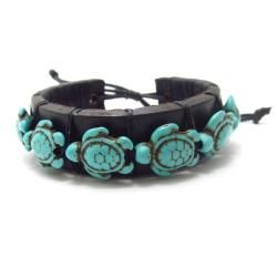 @Overstock.com - Swimming Turtles Turquoise Stones Leather Bracelet (Thailand) - The animal lover in you will love wearing one of these custom turquoise leather bracelets, featuring turtles. Each handmade band features an adjustable pull slide, so it is sure to snugly fit your wrist while still being comfortable.   http://www.overstock.com/Worldstock-Fair-Trade/Swimming-Turtles-Turquoise-Stones-Leather-Bracelet-Thailand/6780820/product.html?CID=214117 $15.29