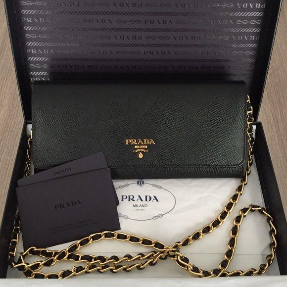 04fcfd09dd18 Prada Portafoglio Tracolla Clutch/Wallet New Prada convertible clutch/wallet  in black Saffiano leather. Detachable strap. Original box and tags included.