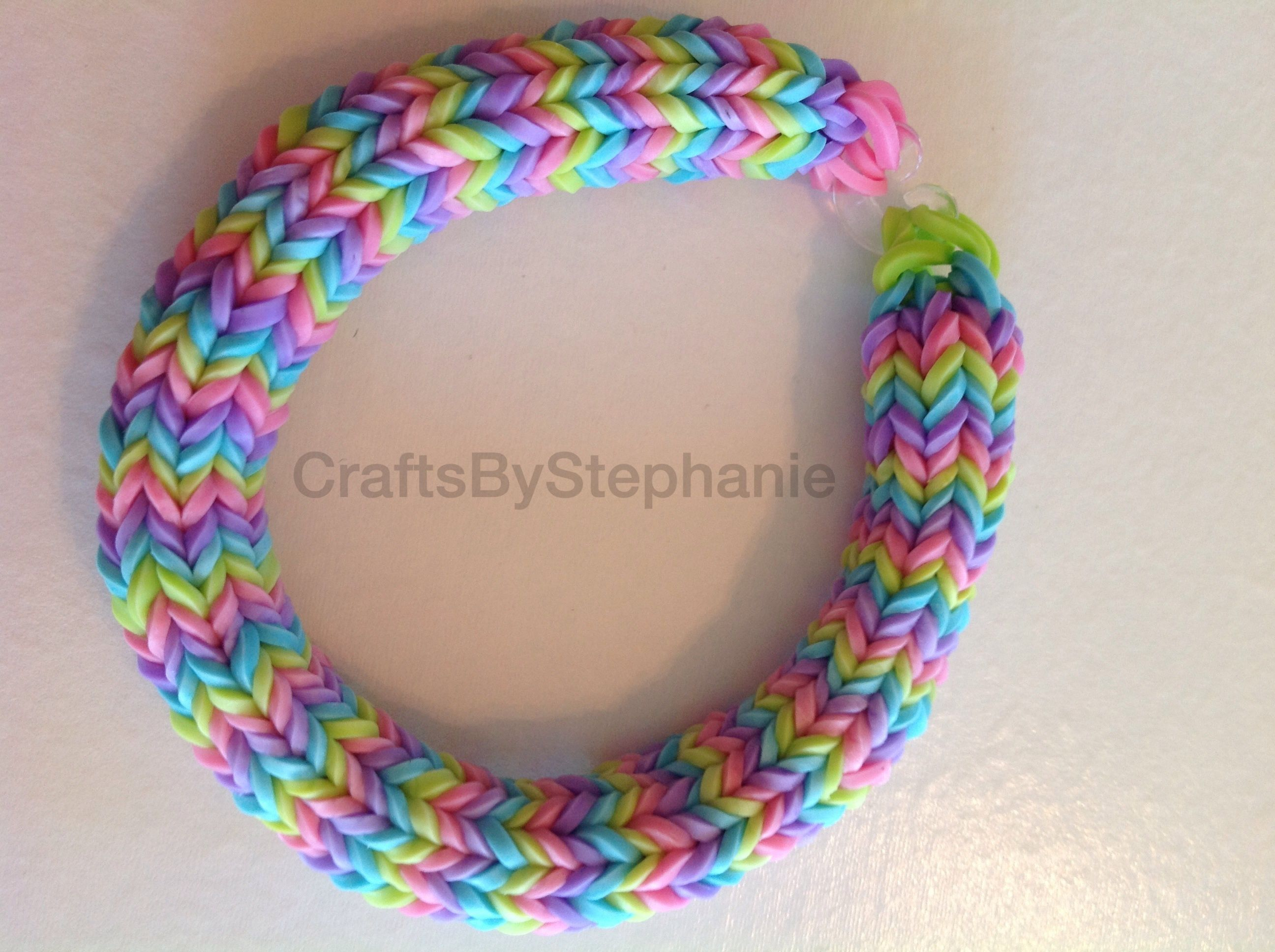 This Is A Green, Blue, Purple, And Pink Colored Bracelet The Colors