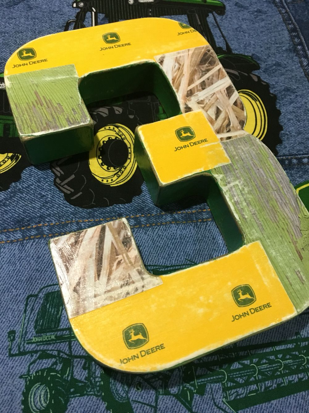 {cardboard #3 covered with scrapbook paper for a table decoration} • John Deere birthday • John Deere theme party • kids birthday • boy birthday party ideas • green and yellow party colors • tractor birthday • John Deere •