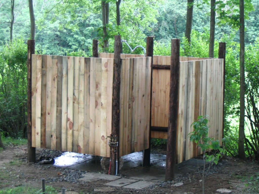 fresh outdoor shower with natural cedar posts locally sewn pine planks and stone floor design
