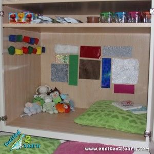 Awesome idea, turn a cabinet into a place to play and explore for your little one