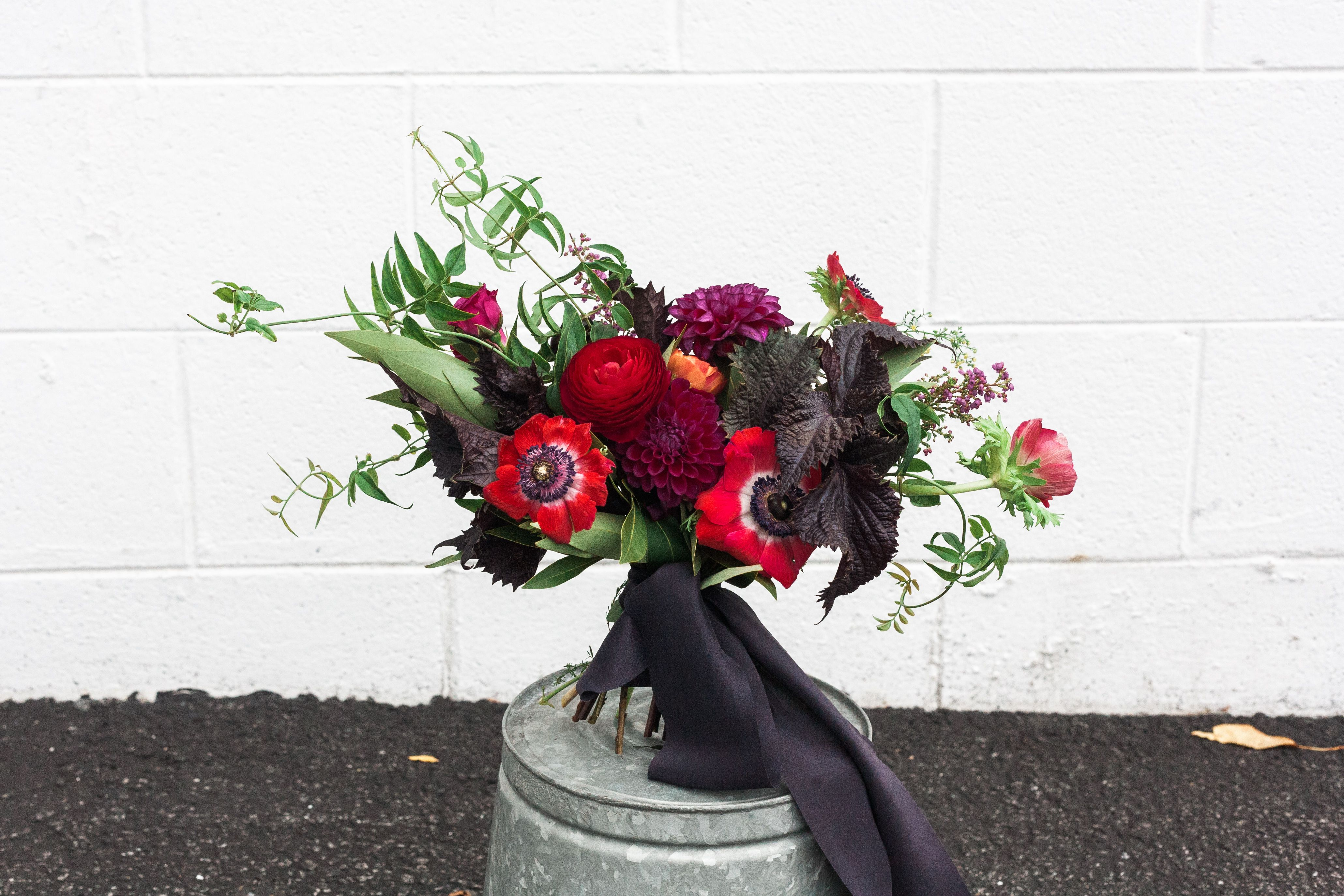 Day of the Dead Engagement Shoot Bouquet   red anemones, dark purple ...