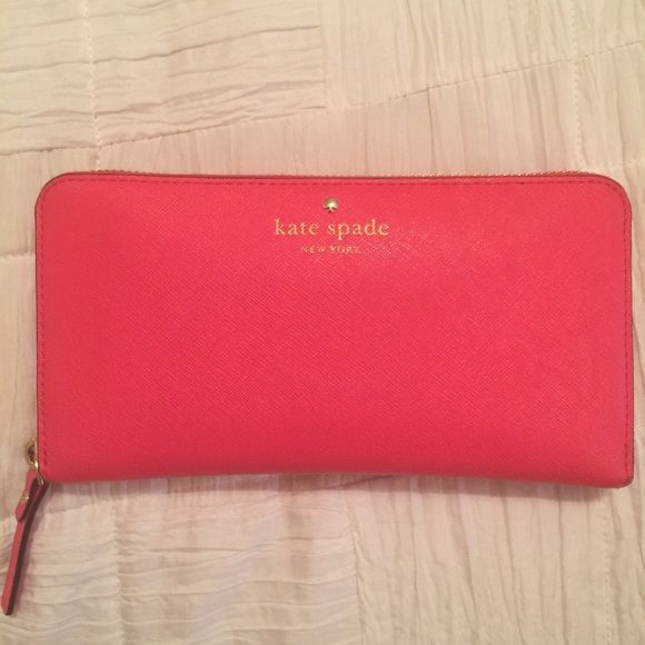 Kate Spade wallet- reddish pink Bought it for $200. Amazing condition. No wear and tear no marks. Reasonable offers only. LIKE NEW kate spade Bags Wallets