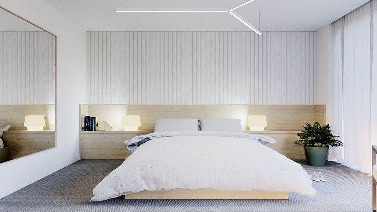 chambre claire avec parement mural en bois, tête de lit en bois ...