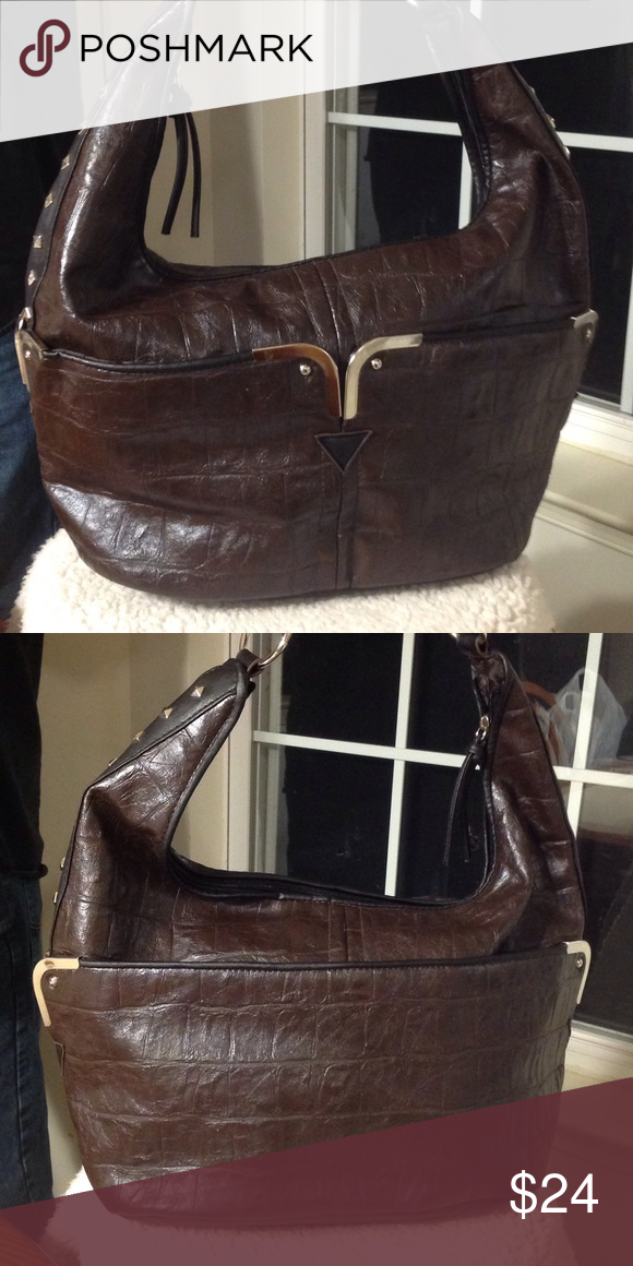 "BEUNO Faux leather large handbag. Large shoulder bag. Vegan faux leather. Dark brown trimmed in black. Lots of pockets and zippers and compartments. This bag will hold it all. Very good condition. Studding on side. Bag measures approx. 15"" x 5"" x 10"". Beuno Bags Shoulder Bags"