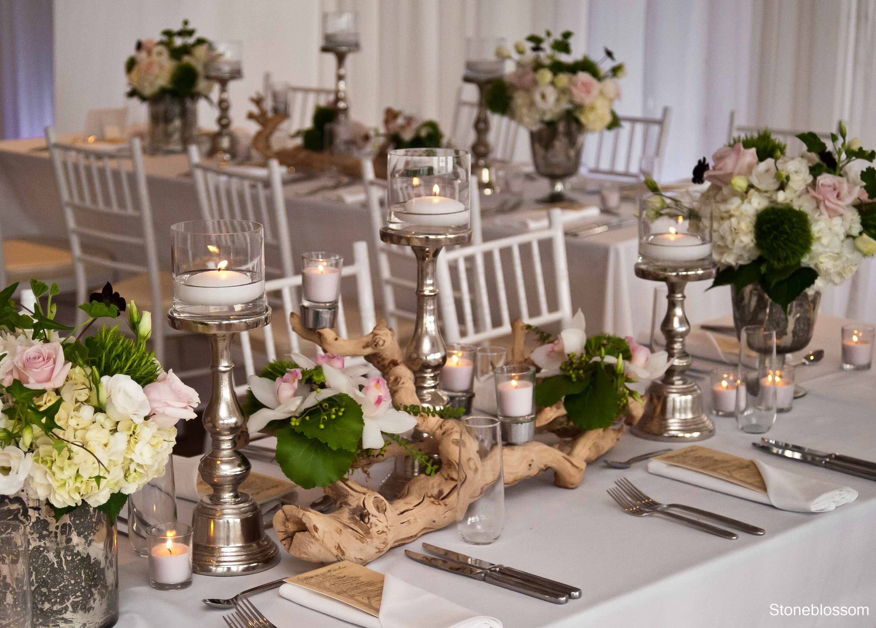 White and greens with a hint of pink rustic driftwood for Driftwood table centerpieces