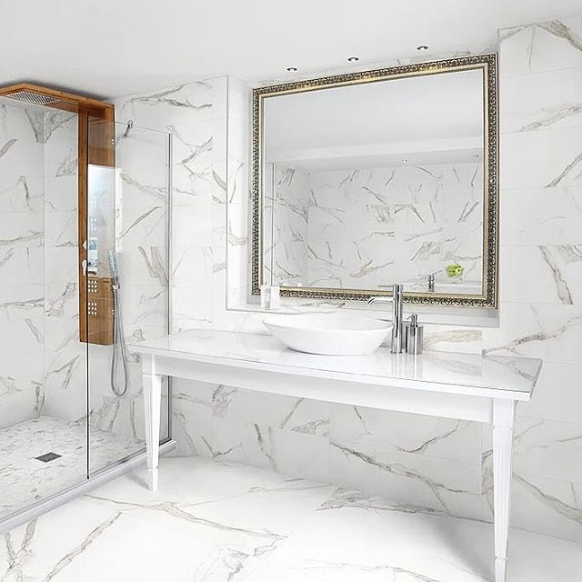 Whether You Re Designing A Commercial Or Residential Bathroom The Look Of Calacatta Gold P Porcelain Tile Bathroom Marble Tile Bathroom Gray And White Bathroom