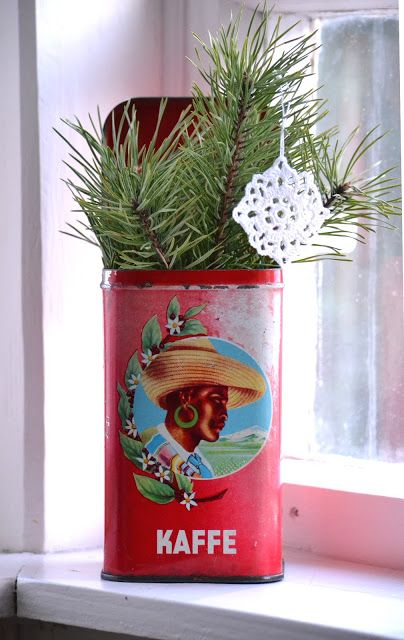 christmas decoration - pine branches & decoration in beautiful old Kaffe tin