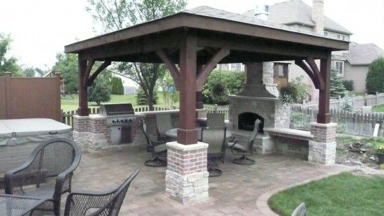 My outside fireplace with pit area and cooking favorite for Built in gazebo