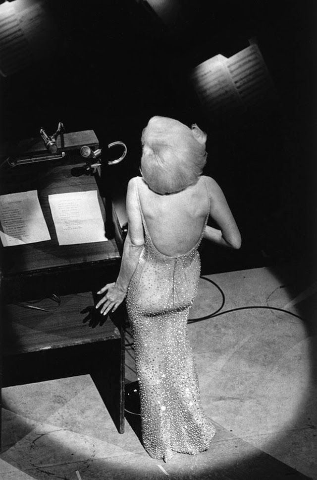 """Marilyn Monroe sings """"Happy Birthday, Mr. President"""" on Saturday, May 19, 1962 for President John F. Kennedy at a celebration of his 45th birthday at Madison Square Garden. Her gown, by Jean Louis, was so tight that she literally had to be sewn into it."""