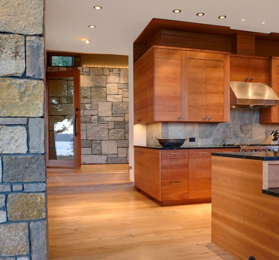 Contemporary Wooden Kitchen Cabinets And Black Marbles