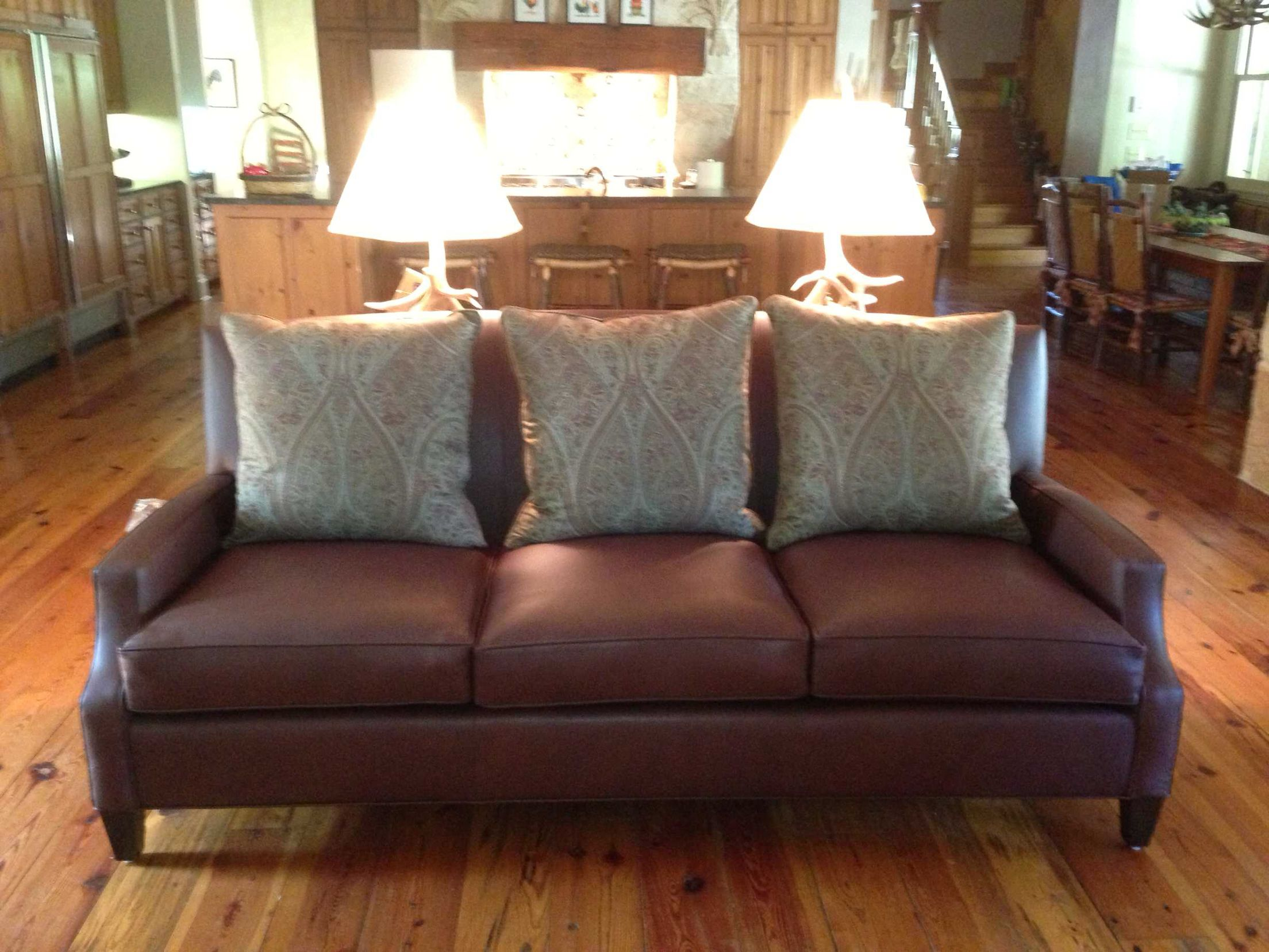Custom made leather sofa with Ralph Lauren throw pillows