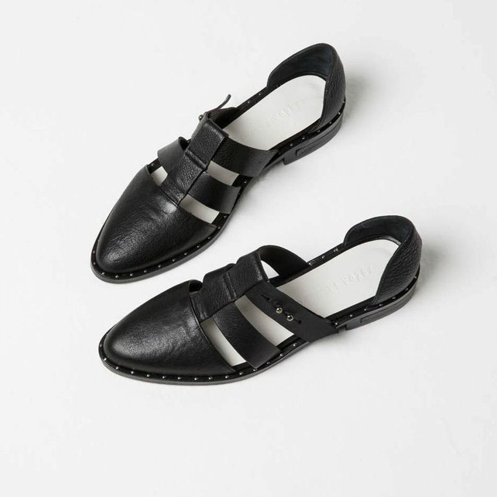 Black calf with studded welt T-strap caged flat 100% Leather upper and leather sole with rubber reinforcement With padded footbed Heel height: 1.25 inches Handmade in Spain