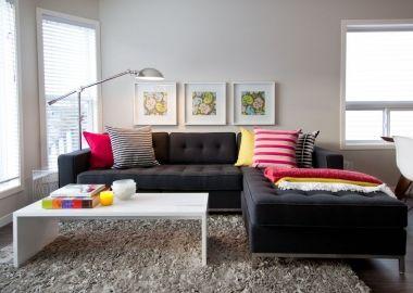 Black Sofa Colorful Pillows