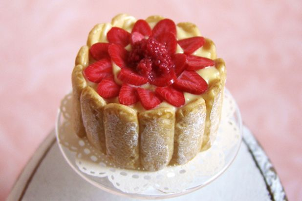 Charlotte aux fraises (made with biscuits, crème patissiere, fresh strawberries, and strawberry sauce)