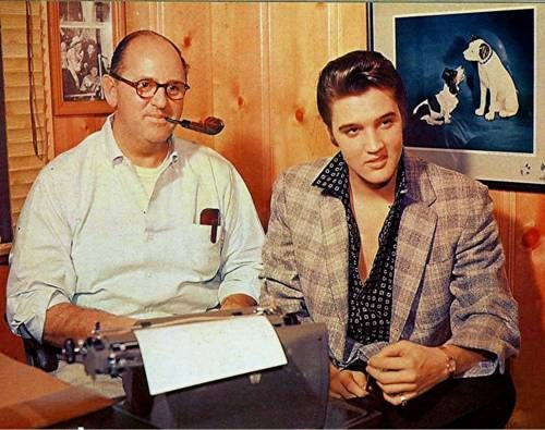 rare: Elvis and the Colonel in his office.