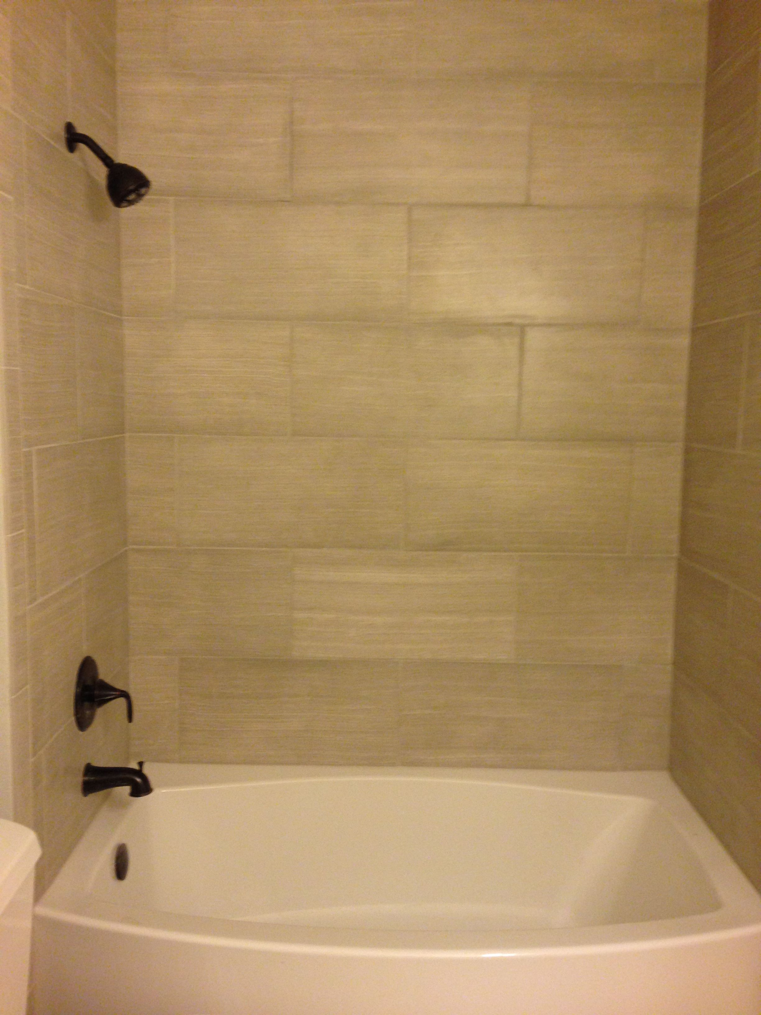 Leonia Silver tile from Lowes Kohler Expanse Curved tub. Perfect tub ...