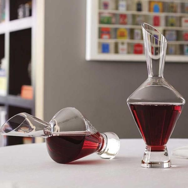 The Shiraz Wine Decanter will help you save space on the tabletop by using it in the upright position, or by laying the decanter on its side for maximum aeration. Made in Europe from lead-free glass, the Shiraz Wine Decanter comes with a slanted mouth for drip-free pouring, and a heavy base so that the decanter won't tip over. #wine #winedecanter