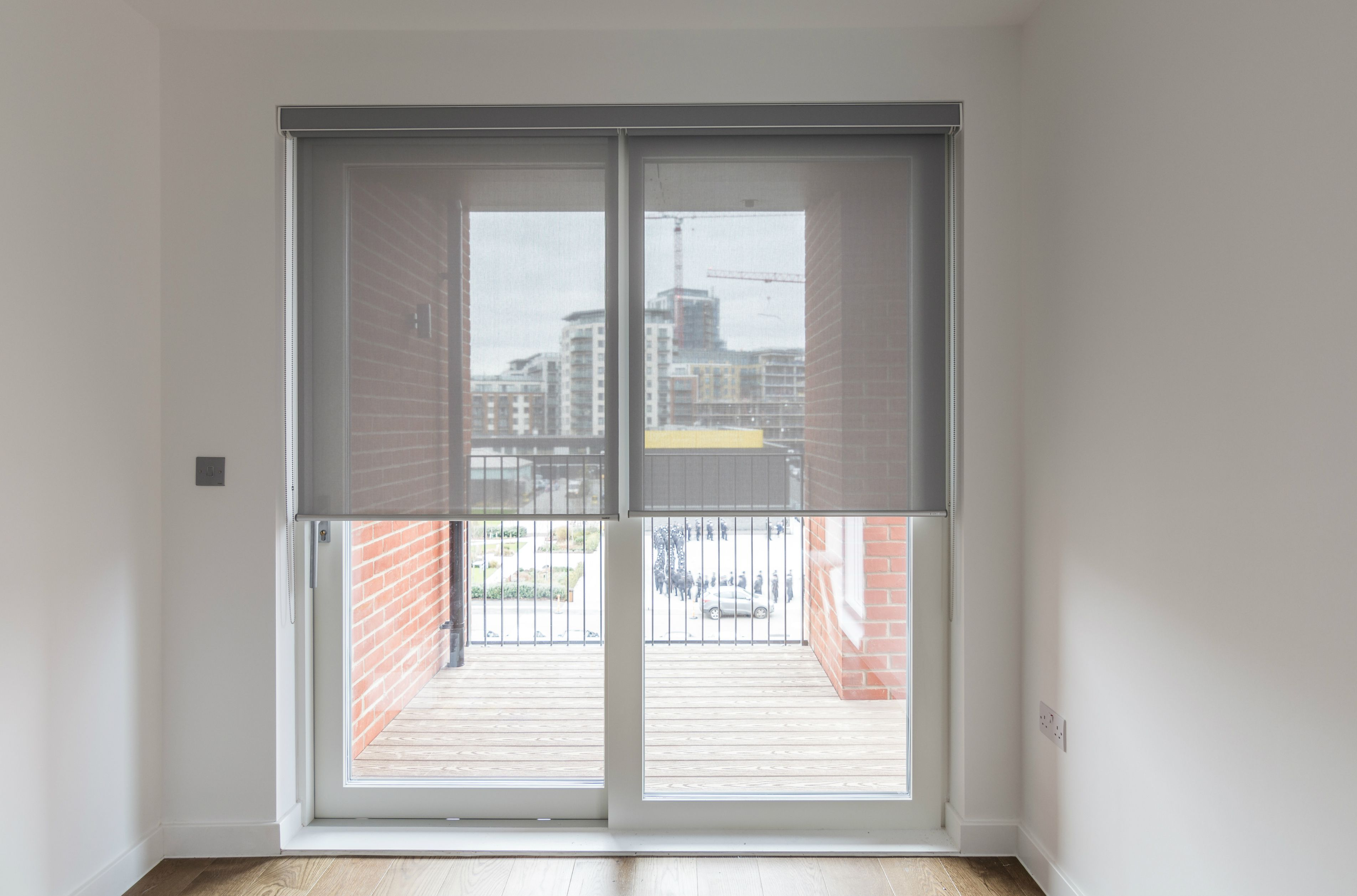 Sunscreen roller blind with matching pelmet fitted to sliding doors