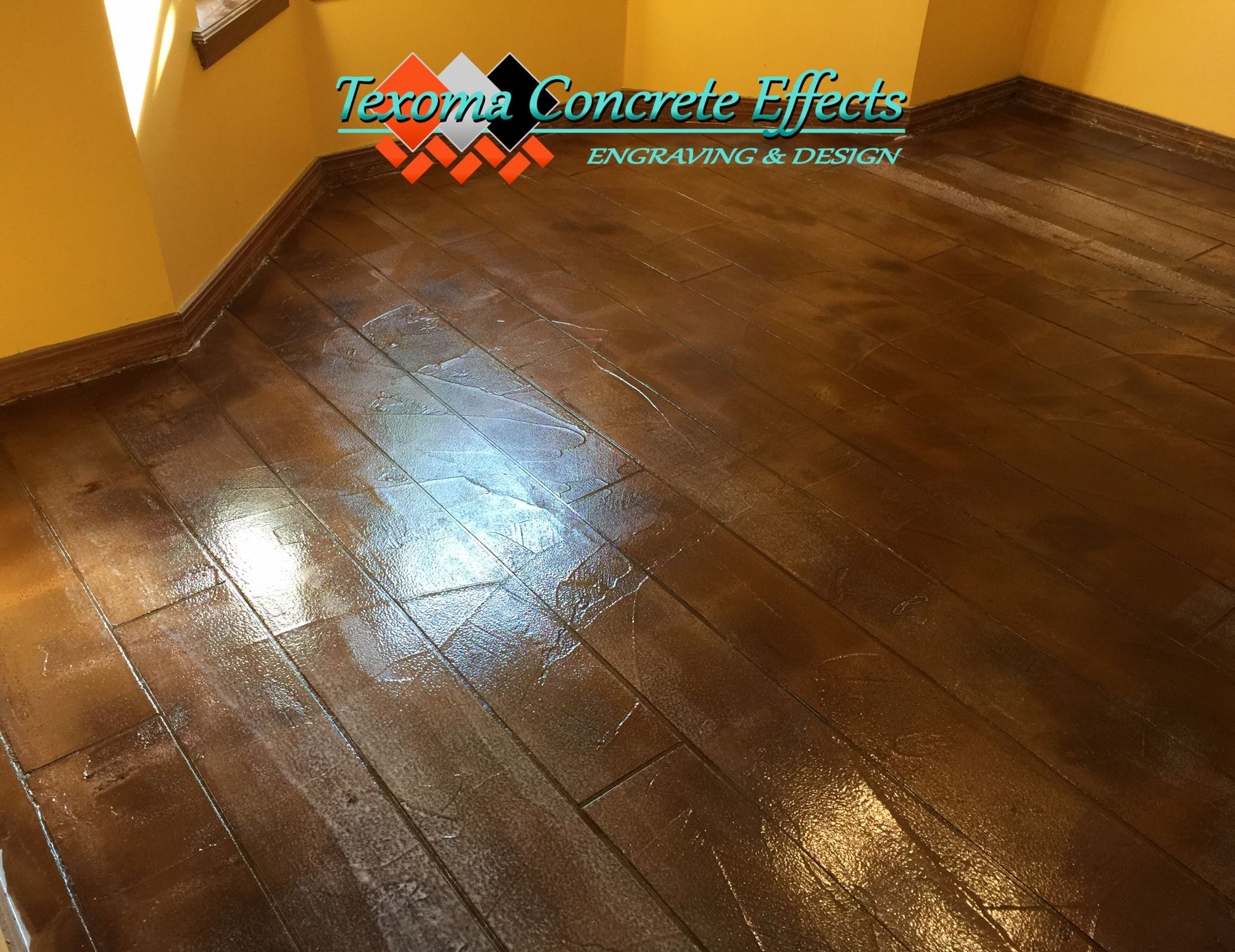 Stained Concrete Textured Overlay Wood Design By Texoma Concrete Effects Iowa Park Tx Concrete Texture Stained Concrete Concrete